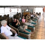Group relaxing on the upper deck of the RV Charaidew. Photo by Rick Taylor. Copyright Borderland Tours. All rights reserved.