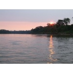 Sunset on the Río Tambopata. Photo by Joe and Marcia Pugh. All rights reserved.